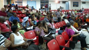 Scores of persons packed the lecture hall of the University of West Indies