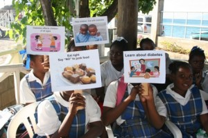 Students on Nevis display signs depicting the ills of diabetes (file photo)