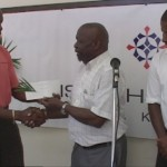 Carnival Chairman Gus Williams (center) receives cheque from McNish Jeffers, while Ellis Hazel looks on