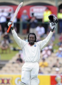 Chris Gayle celebrates his first Test century against Australia - Gordon Brooks photo and DigicelCricket.com