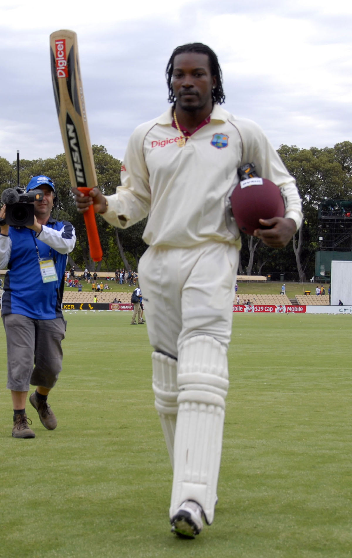 Chris Gayle leaves the field after his masterpiece Gordon Brooks photo and DigicelCricket.com