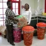 Eudene Wright officially hands over necessities to Food Bank Mgr, Ms Donna Barker