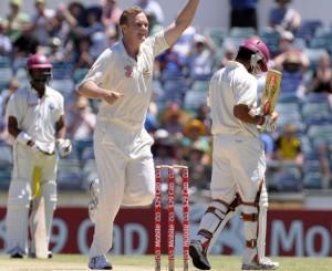 Doug Bollinger celebrates the wicket of Ramnaresh Sarwan - Gordon Brooks photo