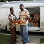 Charity coordinator Eudene Wright loads van with Driver Darion Wickham
