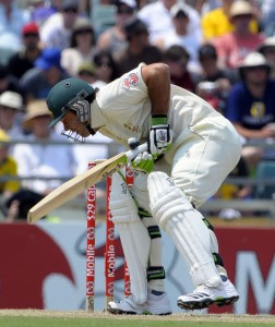 Ricky Ponting is clobbered on the elbow by Kemar Roach - Gordon Brooks photo and DigicelCricket.com