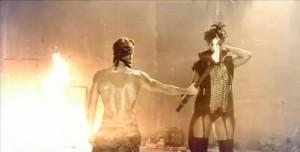 Rihanna given a lit torch (a la Prometheus?)