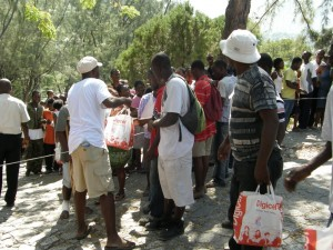 Families camping outside the Prime Minister's office receive aid including food, water, clothes and medical supplies