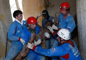 Russian rescuers carry Senvilo Ovri, 11, a survivor of the earthquake, out of the remains of a house in Port-au-Prince January 16, 2010. (REUTERS/Tatyana Makeyeva)