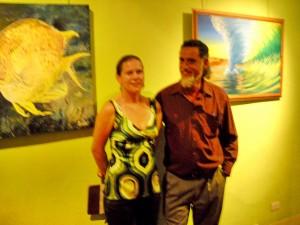 "Anna Didier by her ""Yellow Damsel"" and Garrick Jenkins near his ""Dawn Break"""