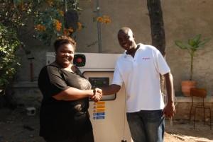 Digicel Haiti PR Executive Marckens Amony presents a generator to Radio Magik 9