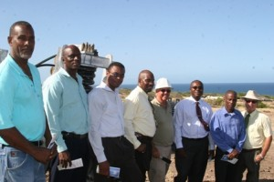 Members of Cabinet in the Nevis Island Administration, led by Junior Minister (fourth from left) with responsibility for Natural Resources and the Environment Hon. Carlisle Powell on a site visit of the Maddens Wind Farm. They are accompanied by Permanent Secretary in the Ministry of Natural Resources and the Environment Mr. Ernie Stapleton (third from right) WindWatt's Staff Electrical Specialist Mr. Peter Haxamer (fourth from right) and Businessman Mr. Clinton Willett (extreme left)
