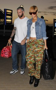 Realising she can only embarrass herself so many times, Rihanna dons camo pants hoping to blend in with scenery native to the central part of the island from which she hails, the one she dissed not so long ago. Ironic, no?