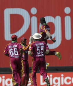 Aerial - Darren Sammy and teammates are elated at another Zimbabwean dismissal - Brooks La Touche Photography and DigicelCricket.com