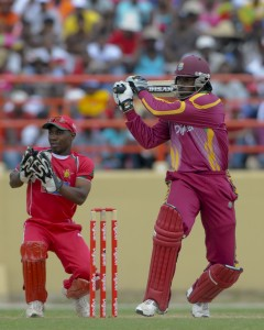 Chris Gayle pulls Prosper Utseya to the boundary - Brooks La Touche Photography and DigicelCricket.com