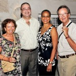 Prime Minister David Thompson and wife Mara Thompson share a moment with Benoît Santerre (right) and his wife Louise (left), who have been visiting the island since 1970. {B'dos Advocate}