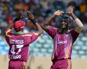 Darren Sammy celebrates one of his four wickets with Dwayne Bravo - Brooks La Touche Photography and DigicelCricket.com