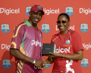 Dwayne Bravo receives his Man of the Match Blackberry Bold 9700 from Digicel St Vincent Marketing Manager Juno De Roche - Randy Brooks photo and DigicelCricket.com