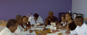 Meeting to discuss French translation of Nativity before the book is published in April 2010. (L-R): R. Romney, L. Mussington, R. Arrindell, F. Badejo, A. Richards, D. Jeffry, J. Illidge, L.M. Sekou. (Saltwater Collection)