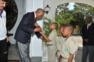 Sir Clifford Husbands passing the Baton to Solomon Dixon of St Cyprians School