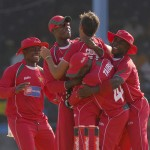 Zimbabwean players celebrate the fall of a Windies wicket - Brooks La Touche Photography and DigicelCricket.com