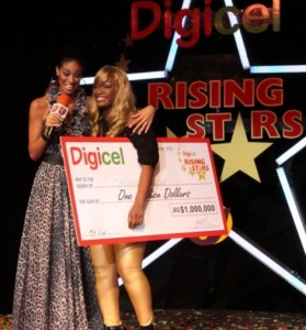 Brown Sugar poses with her cheque of 1 million dollars with Yendi Phillipps