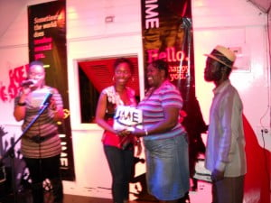 Mary Clarke receiving her Lime prize (2nd from R) and Grantley Sylvester looks on (Extreme right)