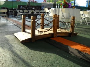 Baby bridge for those too lazy to step over the plastic covering over the wires powering the concert