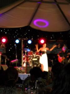Rosemary crooning under a laser-light display