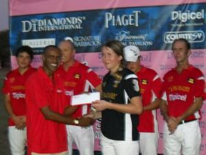 Digicel's Tracey Catlyn acknowledging Rosie Ross as Piaget's MVP