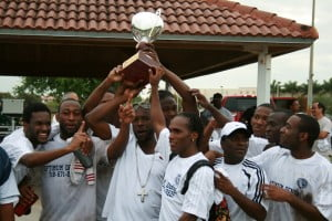 Jamaica College team celebrating their victory with the Ziadie Cup Trophy.