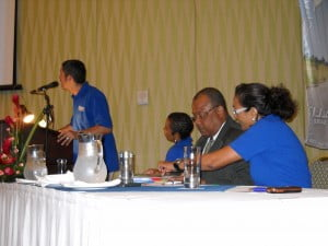 JJ at the podium while at extreme right - Skyviews' Managing Director Jessica Walters makes a point to John Boyce, Min. of Pub. Works & Transport