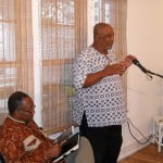 {SEATED} Sydney Simmons & {MIC} Orlando Marville answering queries from the appreciative readers