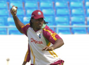 Chris Gayle about to throw during the Windies practice session - Randy Brooks photo and DigicelCricket.com