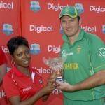 Digicel Sponsorship Executive Nicola Sutherland-Hawkes presents the Digicel Twenty20 trophy to South Africa captain Graeme Smith - Randy Brooks photo & DigicelCricket.com