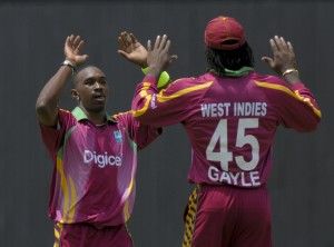 Dwayne Bravo and Chris Gayle celebrate an early wicket - Randy Brooks photo and DigicelCricket.com