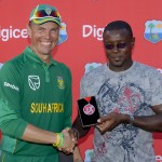 Johan Botha receives his Man of the Match medal from former West Indies captain Richie Richardson - Randy Brooks photo & DigicelCricket.com