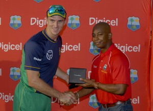 Man of the Match Ryan McLaren receives his Blackberry Bold 9700 compliments of Digicel - Randy Brooks photo & DigicelCricket.com