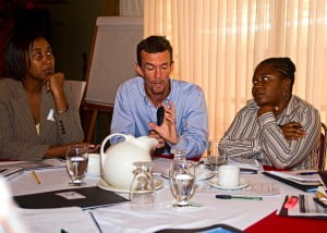 Disaster Manager of the Barbados Red Cross Society, Tamara Lovell (right) listens as one of her colleagues makes a point during the two-day meeting in Trinidad.