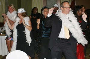 Revellers including COT Media Group's Nigel Worme in boa at extreme Rt
