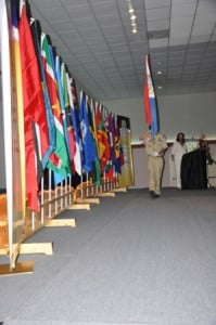 A stout marches with one of the affiliate country flag during the opening ceremony of the CCCU Convention
