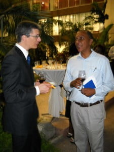 FILE PHOTO - Is this acknowledging the passing of the baton? David Gill chats with Rawdon Adams earlier this year. Bajans have more than had enough of Tweedledumb and Tweedledumber - what is needed is not new wine in old skin or old wine in new skin but a different beverage altogether, since Rawdon says he is not interested in running, then what about Mia? We cannot keep repeating the same rut and expecting something different, that way lies madness!