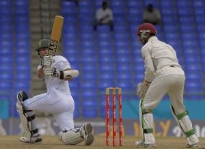Alviro Petersen sweeps to the boundary as wicketkeeper Denesh Ramdin looks on - Brooks La Touche Photography and DigicelCricket.com