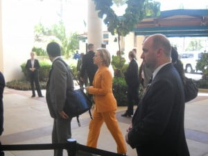 It isn't every day you see Secret service without shades but that's who the bald guy is in front of Hillary as she was whisked away for a Buffet luncheon