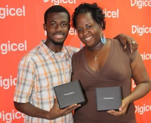 Jamaican winners Marvin Smith and Monique Richards pose with their Blackberry Bolds - DigicelCricket.com
