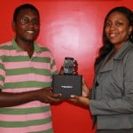 John Duncan receives his Blackberry Bold from Marketing Manager of Digicel Guyana Jacqui James DigicelCricket.com
