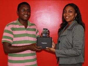 John Duncan receives his Blackberry Bold from Marketing Manager of Digicel Guyana Jacqui James - DigicelCricket.com