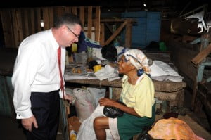 DIGICEL GROUP CEO, COLM DELVES, CHATS TO MRS. CLARICE THOMPSON, A CORONATION MARKET TRADER FROM MANCHESTER