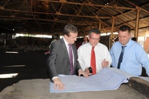 LEFT TO RIGHT – DIGICEL JAMAICA CEO, MARK LINEHAN, DIGICEL GROUP CEO, COLM DELVES, AND DIGICEL GROUP PROGRAMME LEADER, BRENDAN AHERN, STUDY THE PROJECT PLANS FOR THE REFURBISHMENT OF CORONATION MARKET