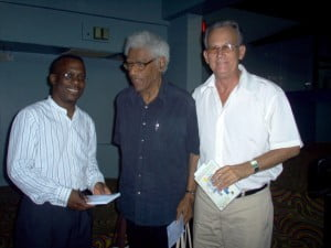(L-R) Lasana M. Sekou (St. Martin), Emilio Jorge Rodríguez (Cuba) with the great Caribbean novelist and political thinker George Lamming (Barbados) at the CSA Conference in Barbados where Corazón de pelícano / Pelican Heart was recently launch. (Saltwater Collection photo)