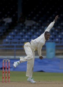 Shane Shillingford bowls on debut - Brooks La Touche Photography and DigicelCricket.com